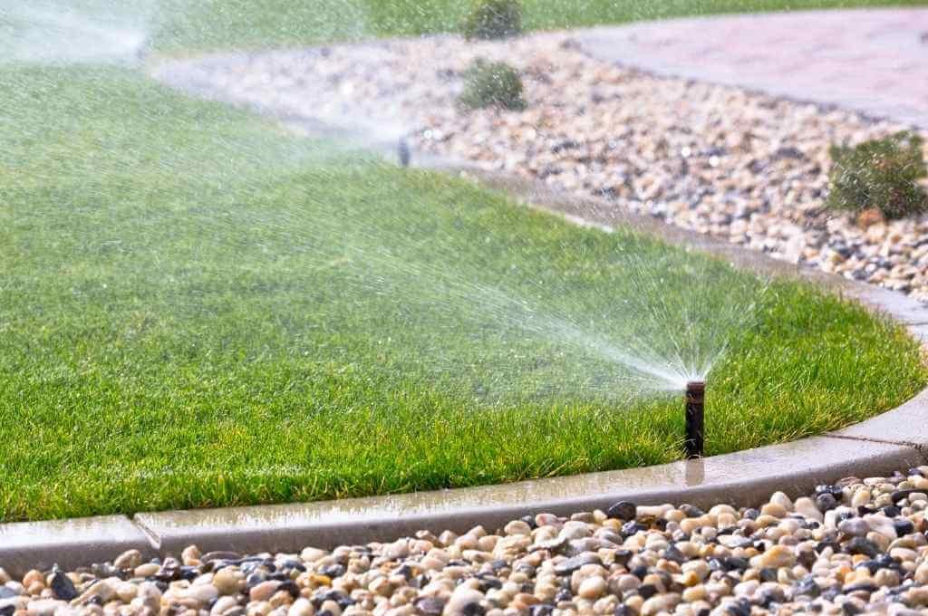 Fixed Spray Sprinklers Watering Lawn